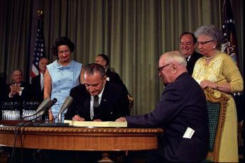President Johnson with former President Truman signing Medicare Act, July 14, 1965